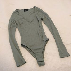 9cb925b6c587d Green Vici body suit. Never been worn